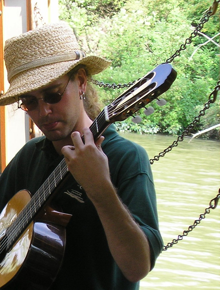 Musician on the Sam Patch Packet Boat