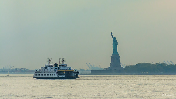 Ms Liberty in Afternoon Haze with Boat