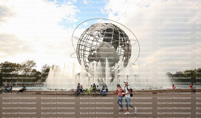 Visitors to Flushing Meadows - Corona Park on August 31, 2016 enjoy the Unisphere, a steel representation of the Earth, built for the 1964-1965 World's Fair.