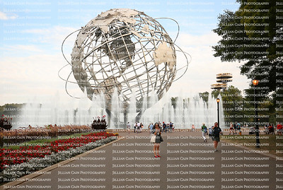 People enjoying the Unisphere, a steel representation of the Earth, built for the 1964-1965 World's Fair.