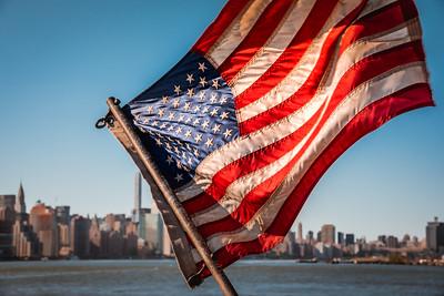 American Flag and Manhattan skyline