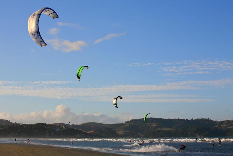 Symmetrical kite surfers at Orewa