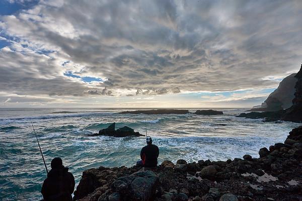 Fishing at Karekare Beach in the Waitakere Ranges Regional Park west of Auckland