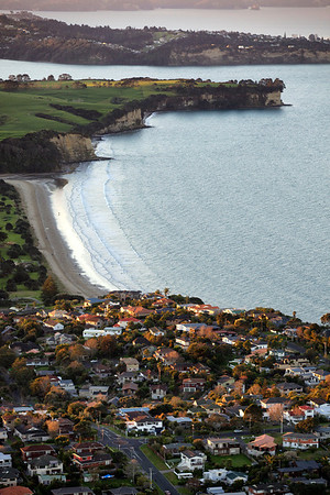 Houses in Torbay and Long Bay beach, looking towards Whangaparoa Peninsula