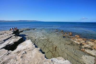 Children enjoying the rocky coastline at Te Mahia on the Mahia Peninsula.