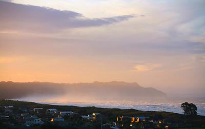 Sea spray at sundown, Waihi Beach, in the Bay of Plenty
