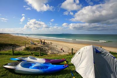 Kayaks & tent at Te Arai Pt, Northland