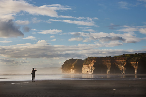 Photographing caves and cliffs at Tongaporutu Beach on the Taranaki coast in New Zealand's North Island