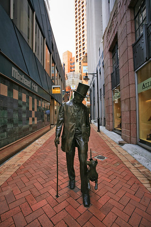 Statue of Victorian gentleman walking his dog, off Lambton Quay in Wellington