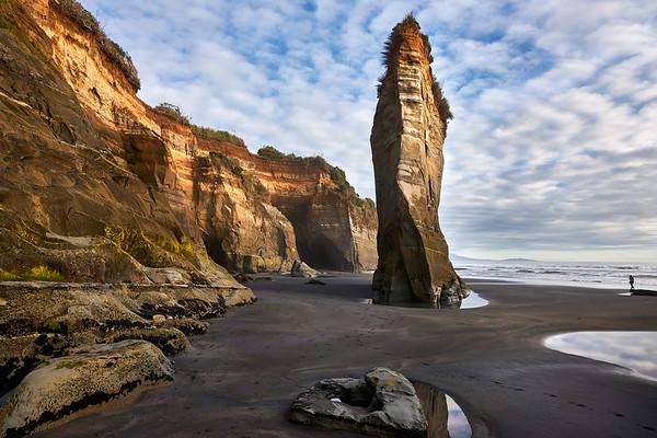 Rock formations with cliffs at Tongaporutu Beach on the Taranaki coast in New Zealand's North Island
