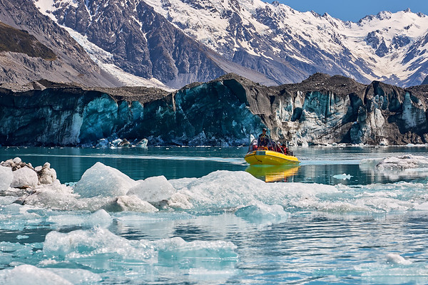 A tourboat navigates icebergs near the face of the Tasman Glacier in Mt Cook National Park