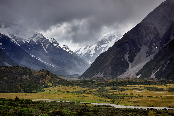 Aoraki Mt Cook, down the Hooker Valley hidden by clouds, with Mt Sefton on the right and Mt Wakefield on the left