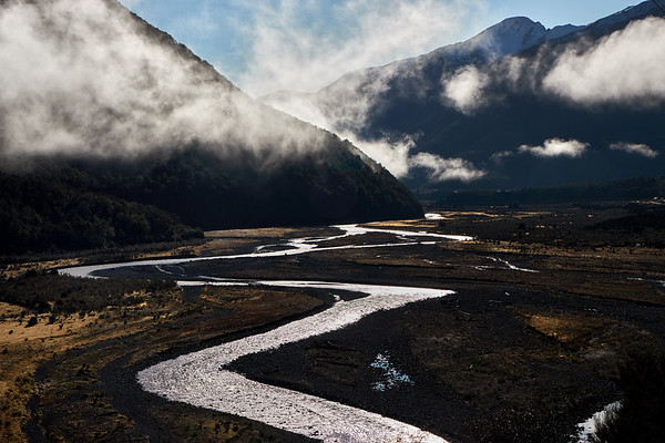 Braided river valley in clearing mist near the Lewis Pass in the Southern Alps