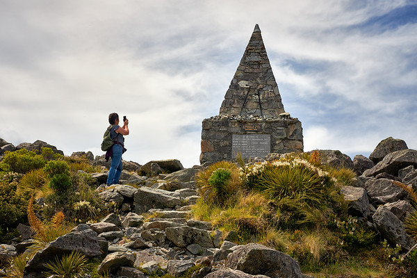 A tourist photographs the  Mt Cook Alpine Memorial, built to commemorate those climbers who have died in the mountains of Mt Cook National Park