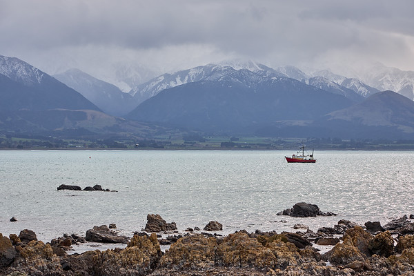 Fishing boat makes its way back into Kaikoura Harbour  in New Zealand's South Island