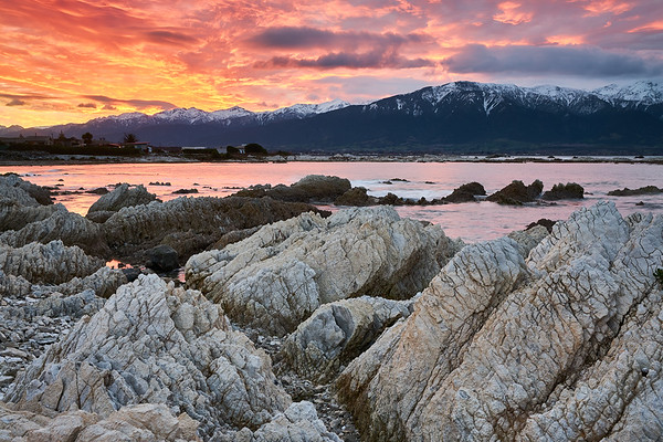 Sunset over Kaikoura in the South Island, a region famous for its marine life and recent magnitude 7.8 earthquake, where geological forces continue to shape its remarkable landscape above and below the water