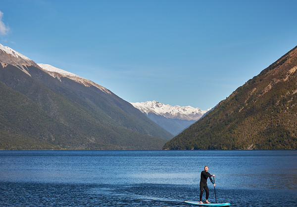 Paddle boarding at Lake Rotoiti in Nelson Lakes National Park in the Tasman District of New Zealand's South Island