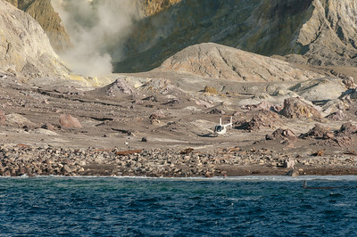 Helicopter monitoring unexpected activity on Whakaari, White Island Volcano.