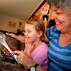 DSC_7461 Northland brown kiwi (Apteryx mantelli). Illustrator Heather Hunt shares her  children's book 'Kiwi-the real story' with Hayley, a young fan from Urquats Bay, Whangarei Heads *