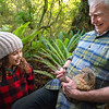 DSC_962  Haast tokoeka (Apteryx australis australis) Peter Hayden holds a 4 month old juvenile tokoeka captured for weighing as part of captive monitoring program, while Rahwa Steel looks on. Photographed at Orokonui Eco-sanctuary for Predator Free 2050 Ltd *