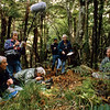 11001-10007 Stewart Island brown kiwi, or tokoeka (Apteryx australis lawryi), filming for the BBC series 'Life of Birds' on Bravo Island. Philip Smith in background watching Sir David Attenborough and the BBC crew beside a tokoeka burrow *