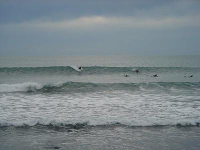 surfers in Raglan