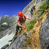 11003-22024 Barrier skink (Oligosoma judgei) was rediscovered in Fiordland in 2005 by rock climbers Bronwyn and Murray Judge. Here herpetologists Tony Jewell in foreground, and Trent Bell search for the skink, and alpine geckos on Barrier Knob, high in the Darren Range, Fiordland.