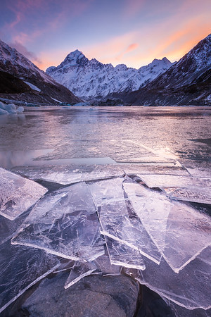 Broken ice on shore of Hooker Lake below South Face of Aoraki Mount Cook