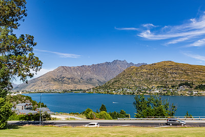 Southern Alps, Ka Tiritiri o te Moana, at Frankton Arm. Foothill housing development noted along the lake. The Frankton Arm is a portion of Lake Wakatipu in Otago South Island of New Zealand.