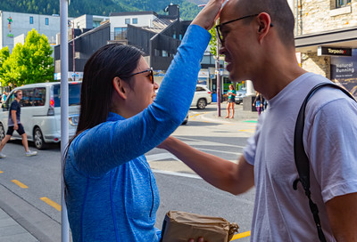 Playful couple on the street of Queenstown Otago, New Zealand
