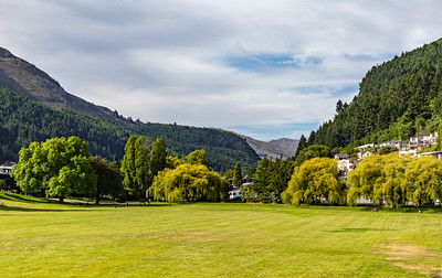 Community park with backdrop of the Southern Alps. Ka tiritiri o te Moana, Queenstown, Otago, New Zealand.