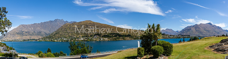 Panorama Southern Alps, Ka Tiritiri o te Moana, at Frankton Arm. Foothill housing development noted along the lake. The Frankton Arm is a portion of Lake Wakatipu in Otago South Island of New Zealand.