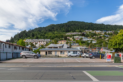 City center parking lot and hillside houses in Queenstown, Otago, New Zealand.