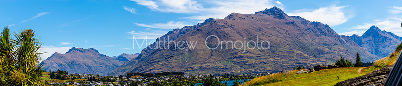 Panorama close up Southern Alps, Ka Tiritiri o te Moana, at Frankton Arm. Foothill housing development noted along the lake. The Frankton Arm is a portion of Lake Wakatipu in Otago South Island of New Zealand.