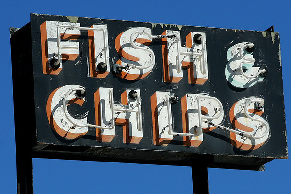 There's a rundown fish and chips sign right beside our house in Nelson.  The shop closed down several years ago.  I love the sign, so I took this photo of it, and I'm going to frame it.  Too bad it doesn't light up at night any more.