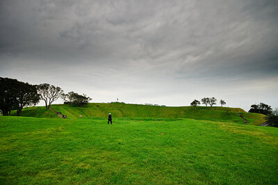 Rim of the Mt Eden volcanic crater, on an overcast cloudy spring afternoon in Auckland