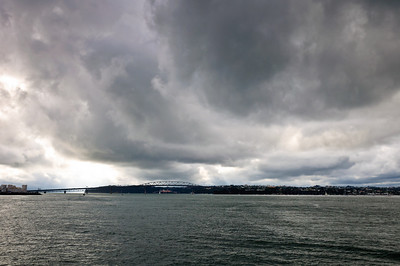 Waitemata Harbour and Auckland Harbour Bridge under stormy clouds New Zealand