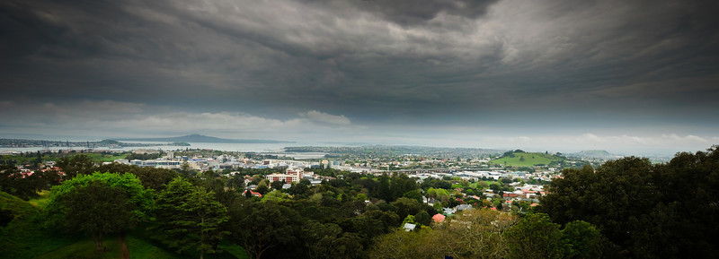 Rangitoto and the Newmarket viaduct from the top of Mt Eden, on an overcast cloudy spring afternoon in Auckland