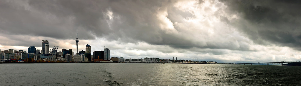 Auckland Waterfront and the Harbour Bridge under stormy sky New Zealand