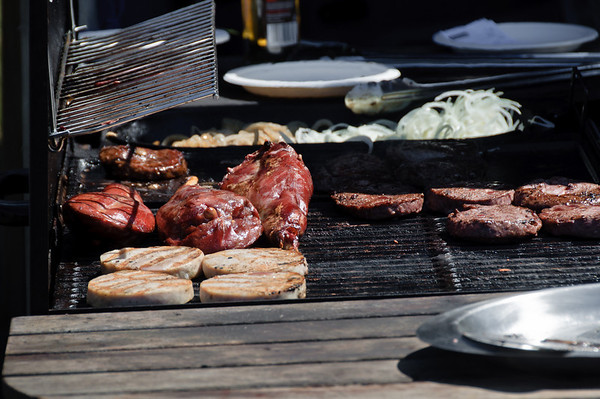 Meats grilling on barbecue Matakawau Awhitu Peninsula North Island New Zealand