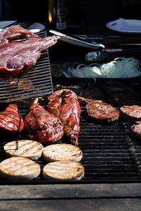 Meats grilling on barbecue Matakawau Awhitu Peninsula North Island New Zealand