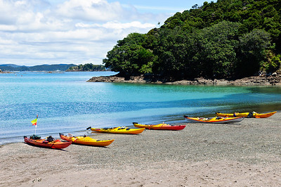 Kayaks on beach Kaimarama Bay Bay of Islands New Zealand