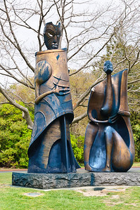 Stylised bronze sculptures of a maori man and a maori woman Government Gardens Rotorua