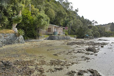 Tidal beach baches Lews Bay Whangateau New Zealand - Apr 2005