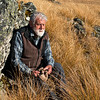 DSC_7821 Emeritus Professor Sir Alan Mark has been one of this country's staunchest defenders of the living land. He is seen here seated in snow tussock grasslands - his specialist field. Te Papanui Conservation Park, Lammerlaw Range, Otago *