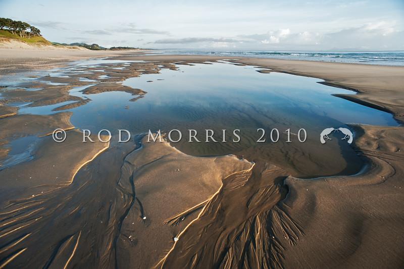 DSC_4559 Exposed pools on sandy surf beach at low tide, East Coast of the North Island. Pakiri Beach