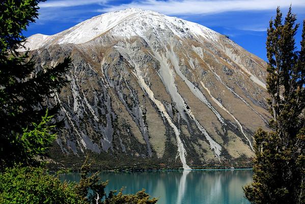 New Zealand's Ben Ohau reflected in  Lake Ohau