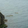 Sea Kayakers paddling around Pitt Head.