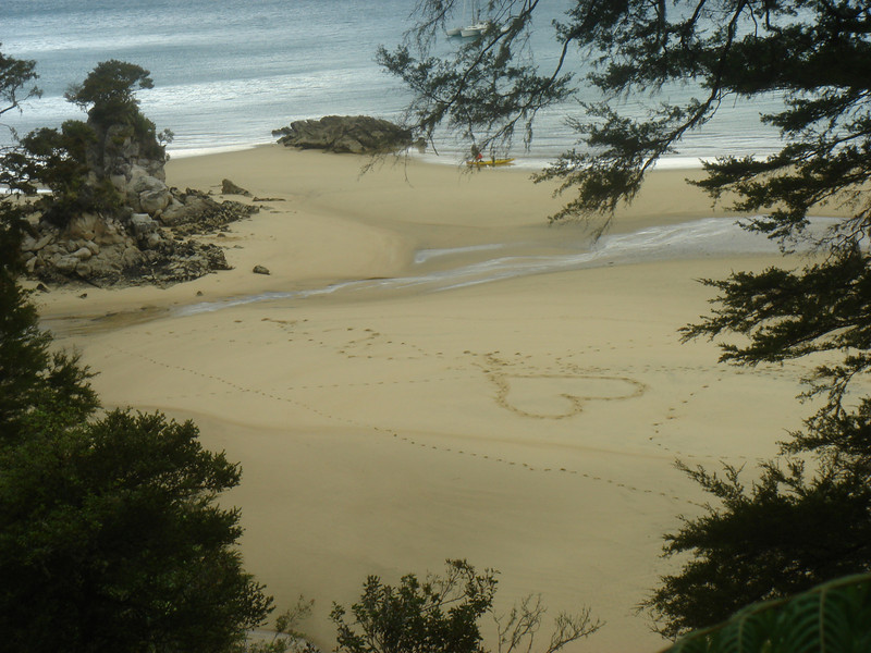 Someone traced out a heart on the beach.