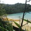 Sea Kayakers stopping at Te Pukatea Bay